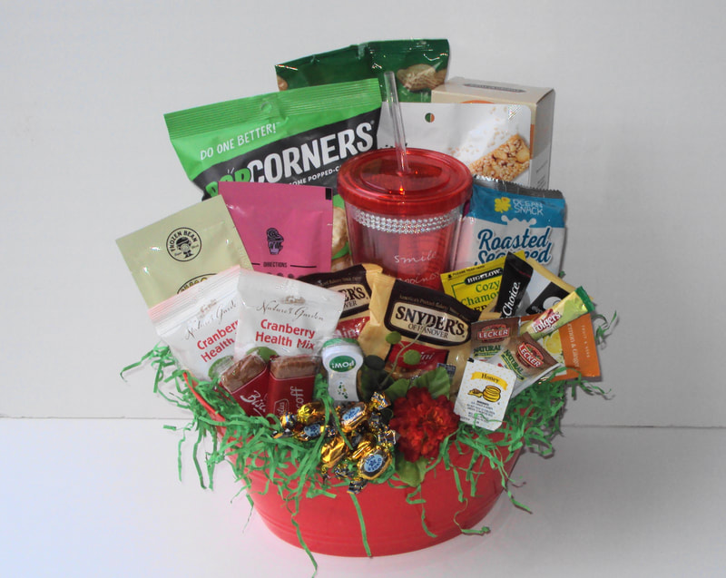 Custom snack basket filled to the brim with cookies, tasty chips, nuts, sample teas of  delightful flavors and add a gift product to boost the style of your basket.