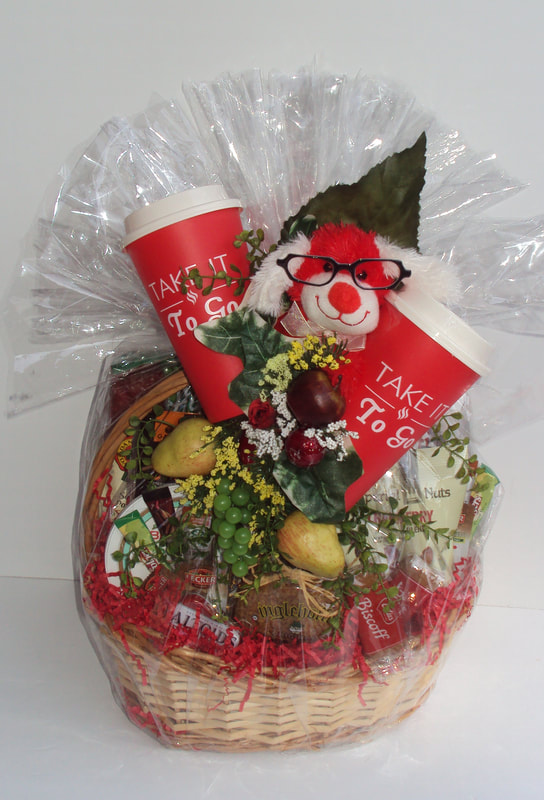 Custom snack design gift basket, deliver from Jax, fl. Beautifully design in a whimsical finish.