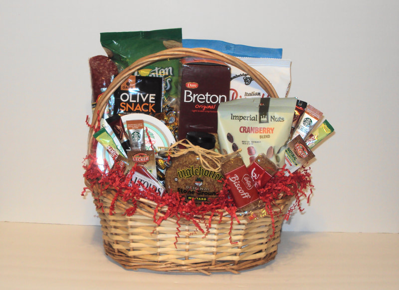 Speciality gift basket fill with cracker, cheese, sausage roll, spreads, nuts and more.