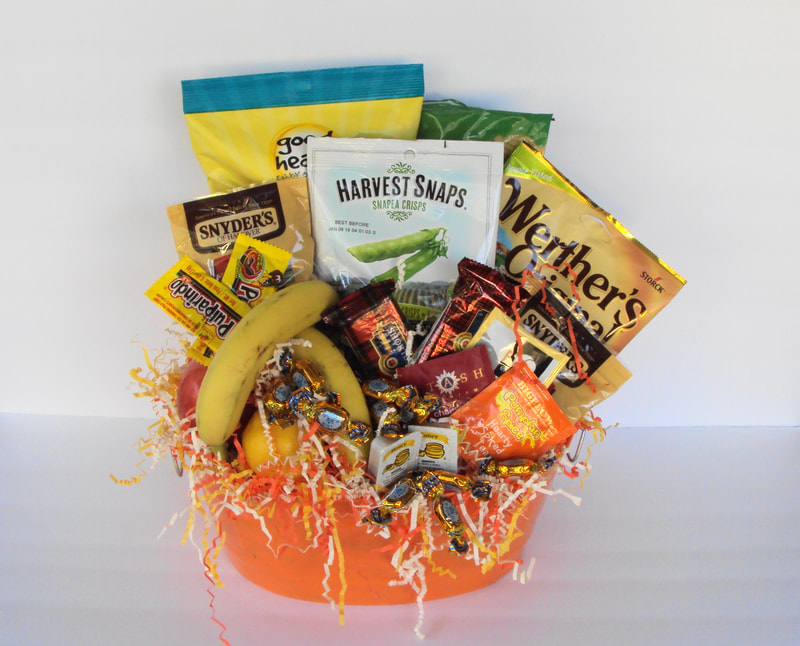 Budget friendly basket filled with fruit, snacks, chips, candies, teas and more. Best seller!!