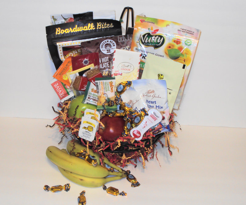 Fruit and snacks arranged in a banana wired basket